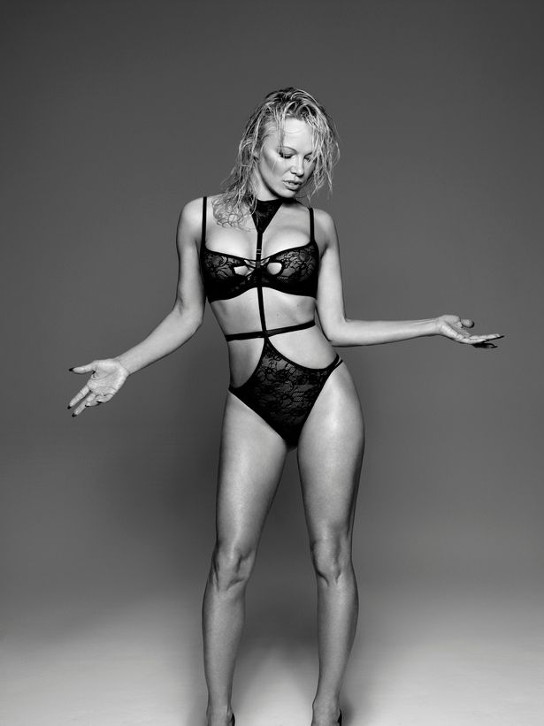 Even At 49, Pamela Anderson Is Quite The Seductress & Her New Lingerie Shoot Is Proof